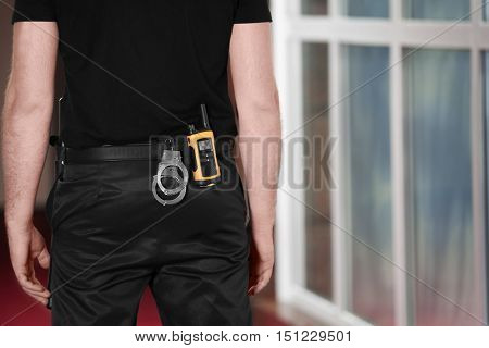 Security man standing back, closeup