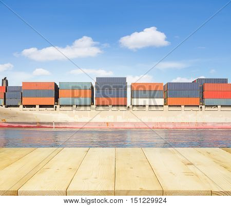 Cargo freight ship and cargo container in sea with clear sky for logistics and transportation background.