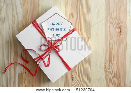 Gift box for fathers day on wooden background