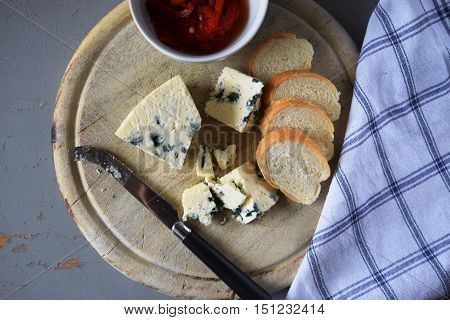 Blue cheese on wooden board.  Cheese board. Cheese slice.