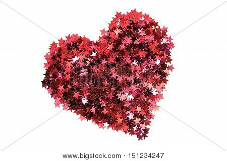Red glitter in the shape of a heart on white background
