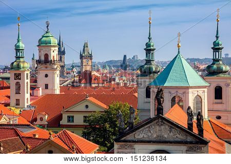 Aerial view of Prague city with red roofs in sunny day, old city center, Czech Republic, European travel