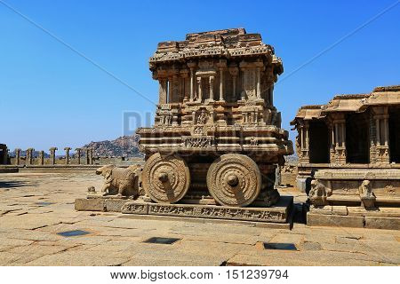 Stone chariot in courtyard of Vittala Temple at blue sky in Hampi Karnataka India