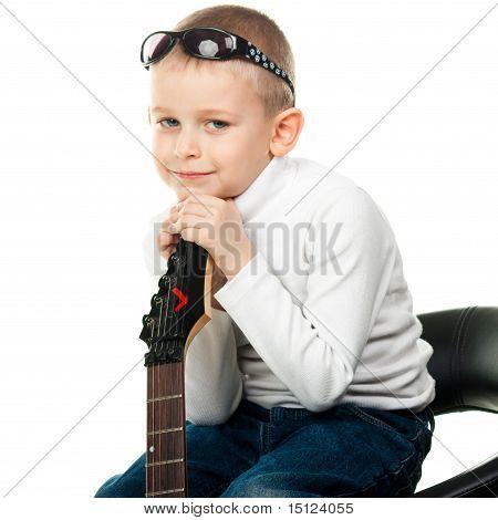 Cute Little Boy Holding A Guitar