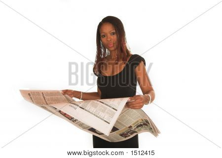 Professional Young Black South African Lady Business Woman In Black Dress Reading News Paper
