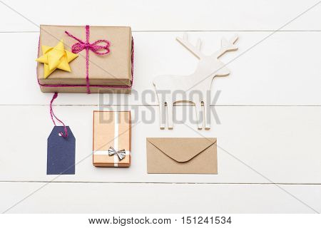 Decorated Christmas Gift On Vintage White Background