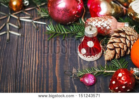Vintage Christmas ornaments tree branches and other decorations on the wooden background