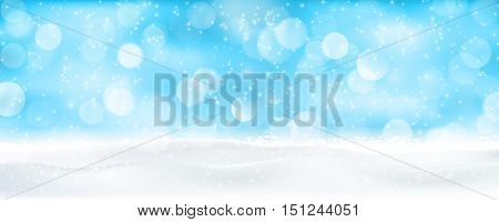 Light effects, sparkling out of focus lights and snowfall for a magical abstract backdrop panorama for the festive Christmas, winter holiday season to come.