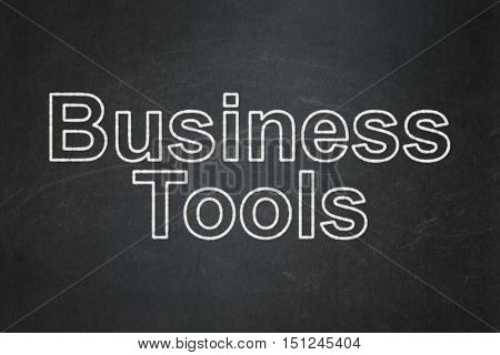 Finance concept: text Business Tools on Black chalkboard background
