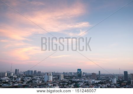 Aerial view of urban city skyline at sunrise beautiful sky and buildings in downtown of Bangkok cityscape background or backdrop in vintage sweet tone and modern retro style