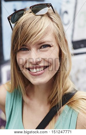 Vivacious smile on beautiful blond woman close up