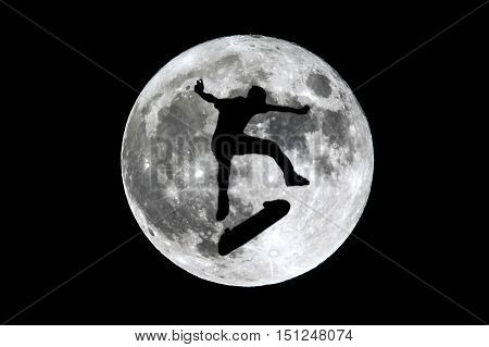 The full Moon is seen isolated on a black background. High contrast high resolution image taken with a full frame dslr camera. Skater silhouette skating in front of the moon.