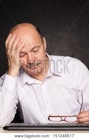 Elderly Man Looking Away Thoughtfully, Pondering The Problem Or Task
