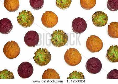 Collorfull sweet muffins pattern on white background