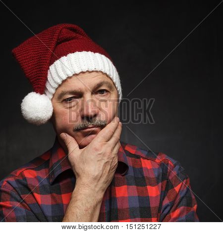 Man In New Year's Cap Looks Sad. Bad Mood Before Christmas