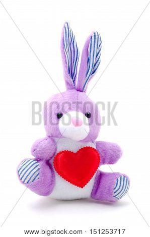 Light purple toy bunny rabbit sitting with heart.