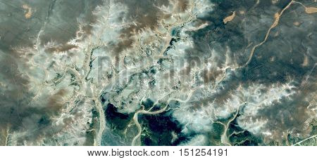 botany fantasy in stone desert,,Abstract Naturalism,abstract photography deserts of Africa from the air,abstract surrealism,mirage in Sahara desert,fantasy forms of green stone in the desert