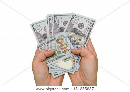 hands holding a handful of money. new one hundred dollar isolated