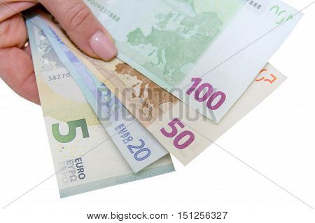 Female hand with stack of euro isolated on white background