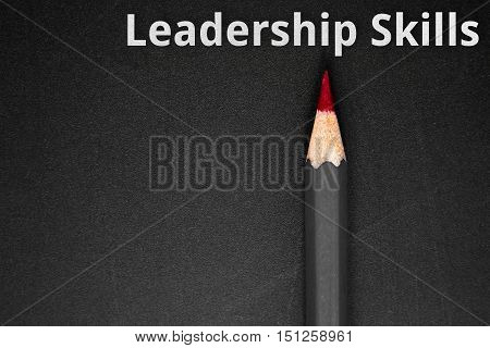 Text Leadership skills with pencil on black background / business concept