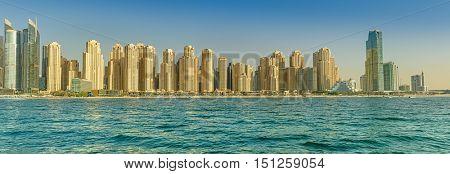 DUBAI, UAE - OCTOBER 09, 2016.  Panoramic skyline of the popular Jumeirah Beach Residence (JBR) in Dubai marina with turquoise waters of the Arabian Gulf