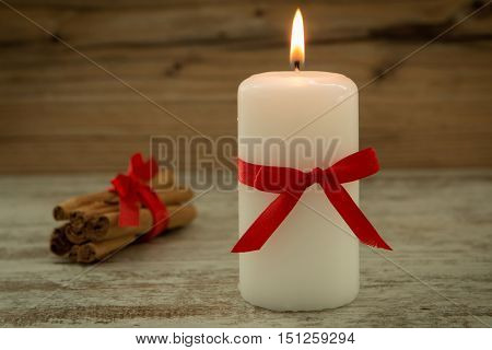Elegant candle decorated for Christmas. Brighten up your illusion