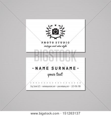 Photo studio business card design concept. Logo with photo camera and laurel wreath and heart. Vintage hipster and retro style. Black and white.