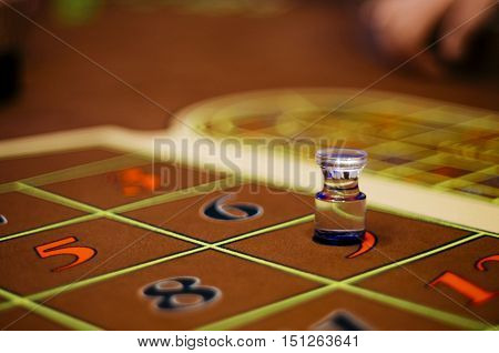 Casino. American Roulette gambling table with a playing chips and dolly on the layout.