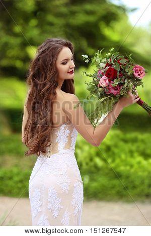 Wedding Portrait Of Beautiful Happy Bride With Long Wavy Hair Wearing In White Lace Wedding Dress Ho