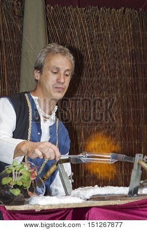 Avila, Spain - September 03, 2016 exhibition of a glass craftsman in a medieval market