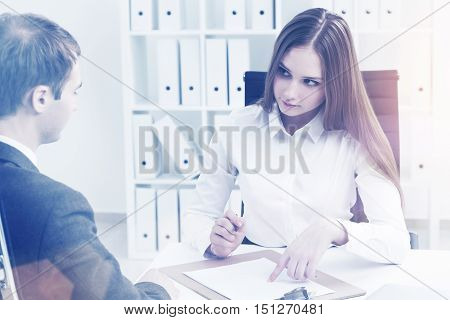 Businessman And Businesswoman At Work