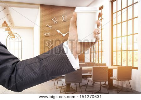 Man's Hand With Coffee In Cafe