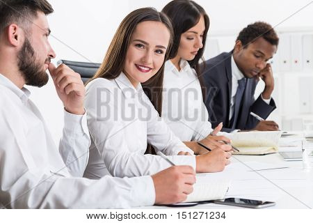 One member of commission is surprised by someone's actions and looking at them in astonishment. Her colleagues are bored