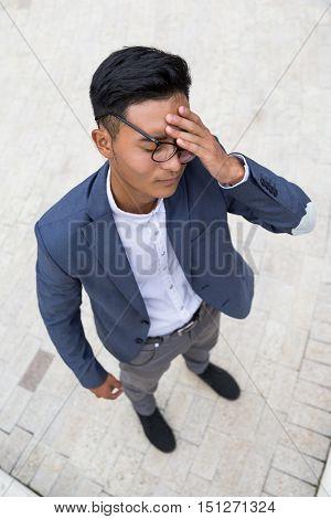 Asian Man With Headache