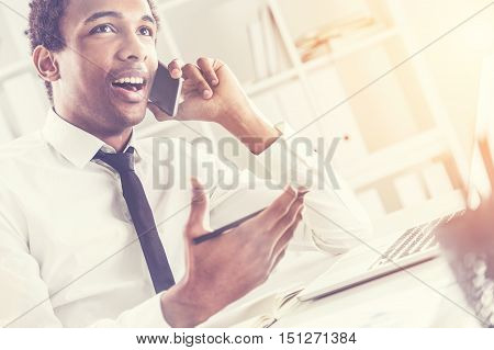 African American Man In Sunlit Office