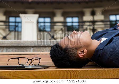 Asian Businessman Sleeping