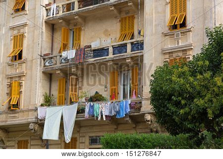 Cloth, towels, fabric sheet after laundry drying hanging outside the balcony, Italian style, building in Portofino, Italy