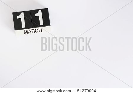 March 11th. Day 11 of month, wooden color calendar on white background. Spring time, empty space for text.
