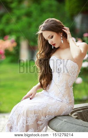Wedding Portrait Of Beautiful Smiling Bride With Long Wavy Hair Wearing In White Lace Wedding Dress