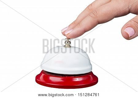 Service concept. Woman's hand above bell isolated on white background