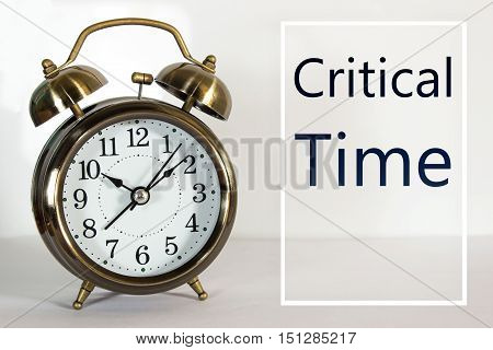 Text Critical time with clock / business concept