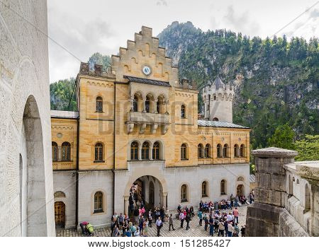 SCHWANGAU GERMANY - JUNE 6 2016: Neuschwanstein Castle is a nineteenth-century Romanesque Revival palace on a rugged hill in Bavaria Germany.