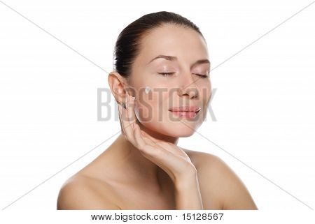 Beautiful Sexy Woman Applying Cosmetic Cream On Skin Near Eyes