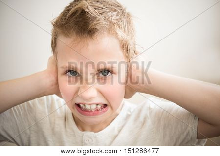Stress and noise. The little boy closed his ears