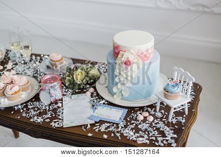 Candy bar with marshmallow on the table, macaroon, cake and cupcake