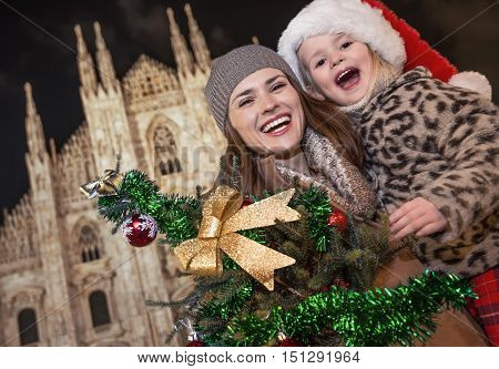 Mother And Daughter Tourists Showing Christmas Tree In Milan