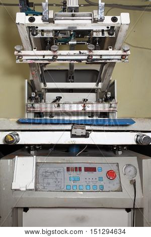 Old printing machine for serigraphy. Technical background