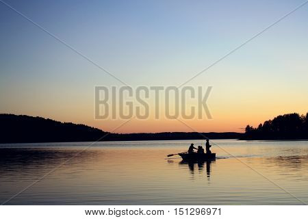 Evening Fishing At The Lake. Boat With Fishermen.