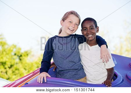 Laughing Brothers Embracing Outside