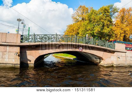 ST PETERSBURG RUSSIA-OCTOBER 3 2016. Autumn landscape of St Petersburg - Lower Swan bridge over the Swan Canal located on the Moika river embankment in St Petersburg Russia
